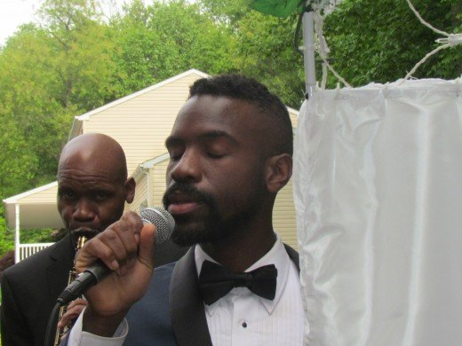 "Emmanuel Blake, performed the song ""Crazy Love"" for the couple to march in on."