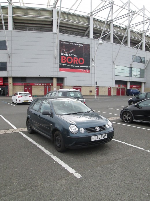 My daughter's 2003 VW Polo at the Riverside Stadium, Middlesbrough - Mecca for Teessiders. So far this car's been everywhere from the South Coast to the tops between Swaledale and Wensleydale. Almost a 'Landie'.