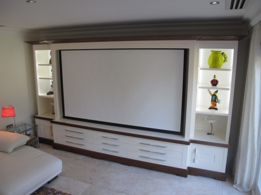 A wood veneered home cinema surround