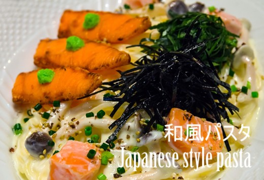 Japanese style pasta with salmon and nori (seaweed).