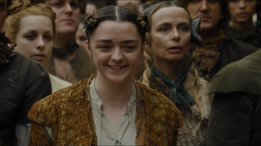 Arya laughing at Joffrey's death when no one else is