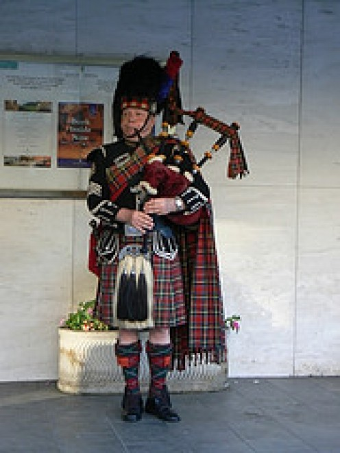The Scottish Piper pipes  in the Haggis and Cock a Leekie for a typical Burns Night Celebration on the Birthday of the famous Scottish poet.