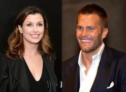 Bridgete Moynahan, left, Brady's ex-wife, and Tom Brady flexing his arrogant smile