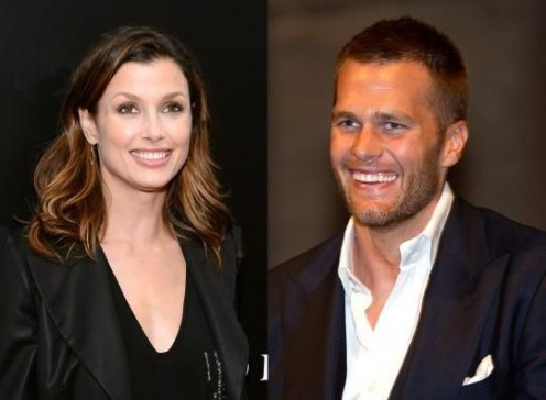 Bridgete Moynahan, left, Brady's ex-wife, and Tom Brady flexing his arrogant smile
