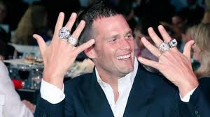 Happy and arrogant Tom Brady shows off his Super Bowl rings