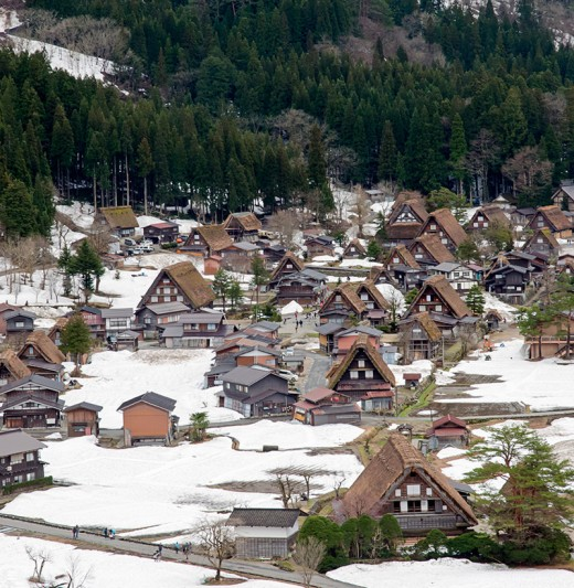 Shirakawa-go, Japan, covered in snow. Farmers here once braved harsh winters year after year. Today, the town is a renowned UNESCO world heritage site, and a tourism magnet.