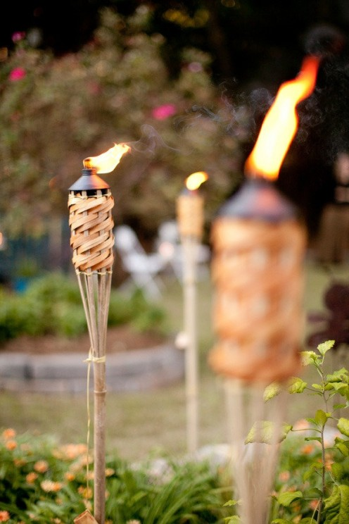 Tiki Torches burning with Citronella Oil.