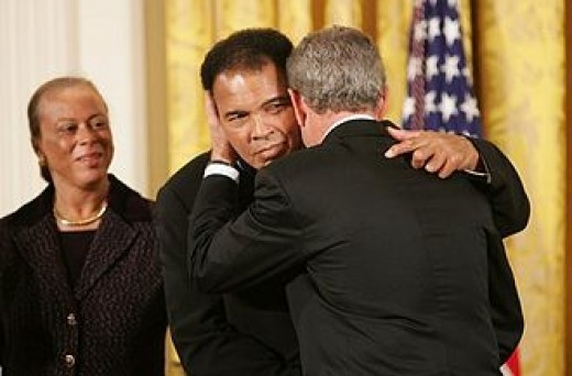 Ali, his wife and President George W. Bush awarding him the medal of Honor.