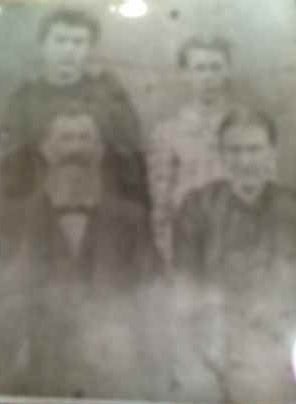 """Isaac """"Ike"""" Endsley Slaven (front left), with his mother Mary Elizabeth Slaven nee Christy (back left), son Sam (back right), and grandmother Ellendor """"Nellie"""" Slaven nee Moore.  Ike is the author's great grandfather."""