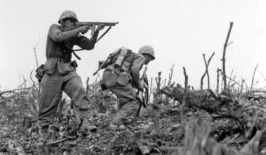 Two Marines battle their way up Kunishi Ridge during the Battle of Okinawa in June 1945.
