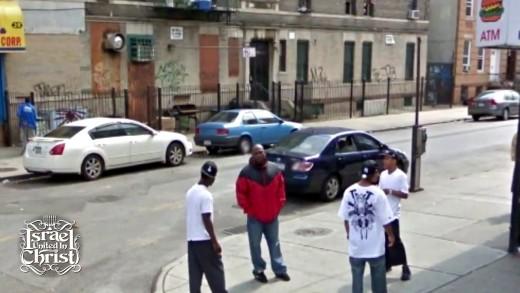 Black men standing on the corner.