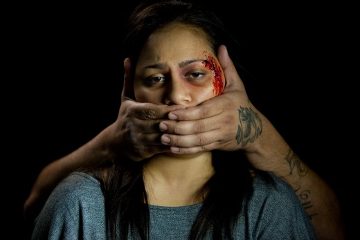 A woman is silenced by force