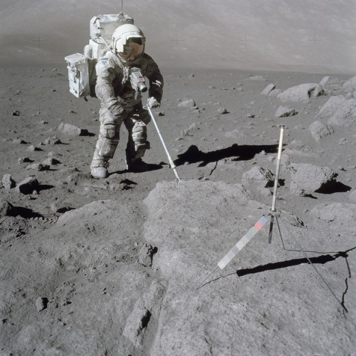 Geologist Harrison Schmitt, Apollo 17 lunar module pilot, sampling the moon's surface