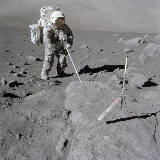 Geologist Harrison Schmitt, Apollo 17 lunar module pilot, sampling the moon's surface