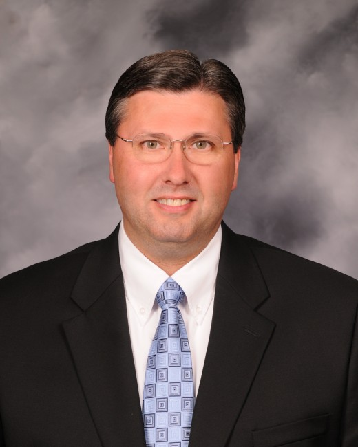 This man is president  of F&M Bank in  Galesburg and  Peoria Illinois area. See how well-dressed he is?