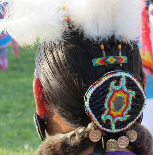 First Nation headdress of feather and beads.