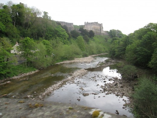 The view downriver from the old bridge on the Hipswell road, with the curtain wall of the castle that overlooks the River Swale