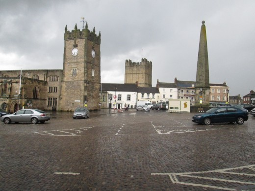 With the castle keep in the rear, overlooking town and river, a view across the market square to the market 'cross' and the Green Howards' Museum in the church