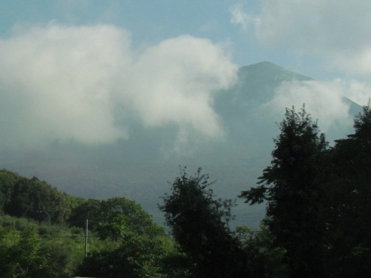 A photo of Mount Vesuvius which erupted around 79 CE near the coast of the Bay of Naples, where visitors can see where the destruction of Pompeii occurred and its ruins that remain today.