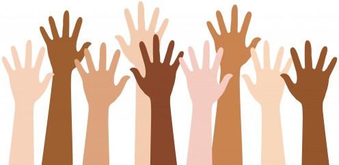 Hands raised are a sign of a group raising awareness on a certain cause