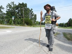 Man walks across  nation in 2015 to  raise awareness for  some problem that I forgot