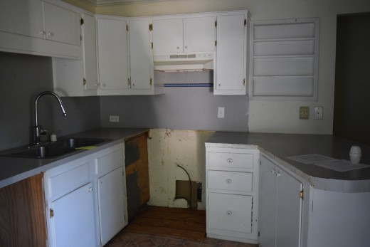 Old style cabinets with rotten floor