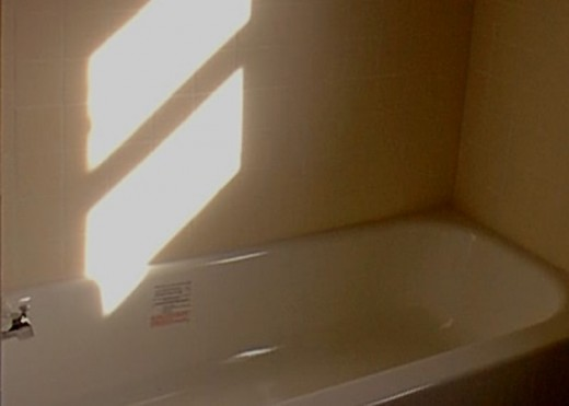 The replacement bathtub with surrounding tile walls
