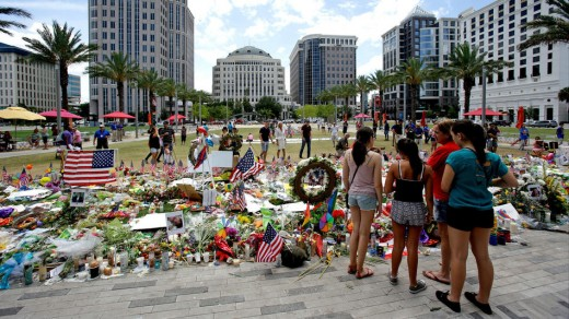 People pay their respects to an ever growing make-shift memorial at the Dr. Phillips Center for the Performing Arts, just north of the Pulse Nightclub in Orlando, Florida.