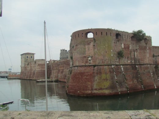 The ruins of a castle in the port of Livorno, Italy.