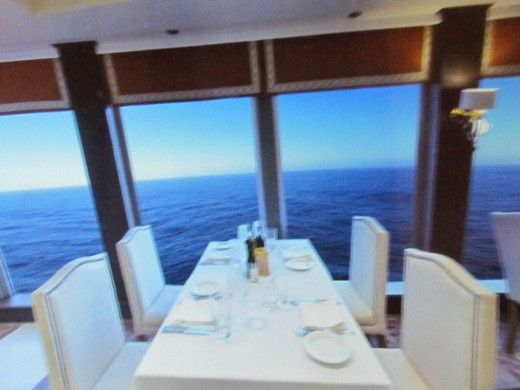 A dinning area near the windows of the ship.