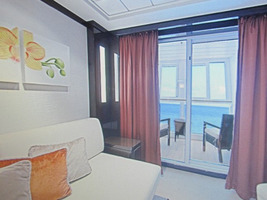 A photo from the website of one of the staterooms with a balcony on the Epic Norwegian.