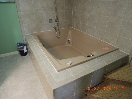 The MONSTROUS tub in the master bath.  OH yes it is also the shower in the master bath.