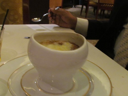 A delectable French Onion Soup that we had at Le Bistro Restaurant. It was covered with a Gruyere Cheese Crust.