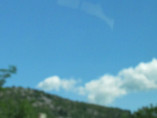 Mountainous are surrounded by white puffy clouds while we were in Nice, France.
