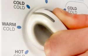 Toss it into the washing machine on cold water setting.