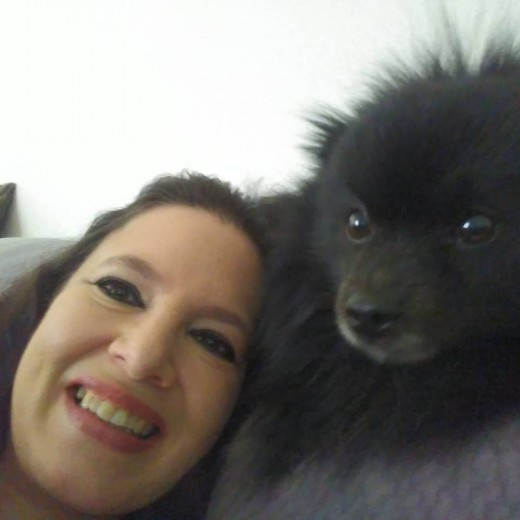My Pomeranian Oliver and I on the sofa at Home in Orlando, Florida.