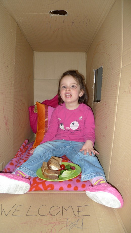 Eating lunch in a cardboard box is as fun as if it was a real castle.