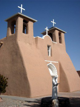 The lesser known front of the Ranchos de Taos Mission sits away from NM Highway 68, but nonetheless it is well known by the parishioners, for this is where they enter the building for mass.