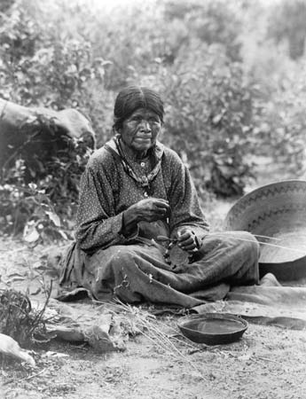 Paiute woman with baskets
