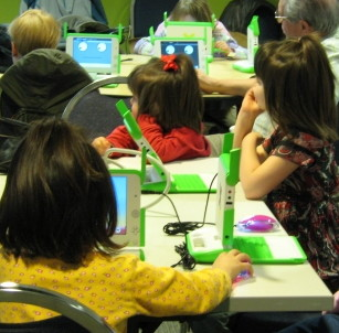 Cropped photo of very young children in a One-Laptop-Per-Child environment with XO-1 computers.