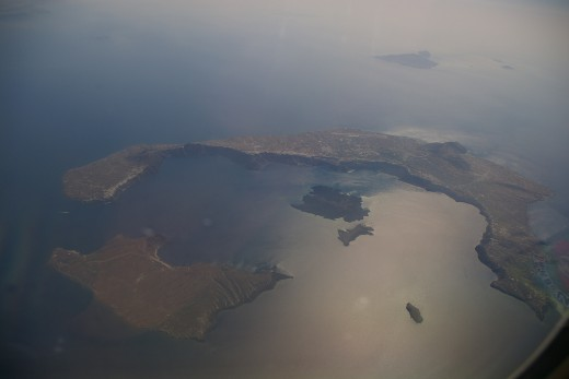 Image from airplane showing the Santorini Island, the Volcano (in the middle), Therasia Island (down left) and Aspronisi (down right corner)