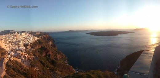 The Caldera of Santorini with the volcano on the sunset time