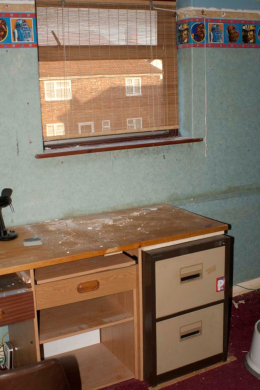 Removing a section of desk creates easy access to the window and access the corner of the bedroom for the new wardrobe.