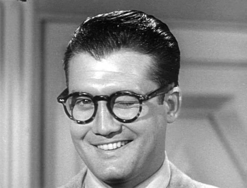 The late George Reeves was the original TV Superman. Here he is as Clark Kent, mild-mannered reporter for The Daily Planet