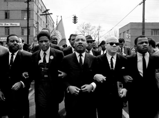 John Lewis standing left of Dr. Martin Luther King Jr, March 1, 1965, during the march from Selma to Montgomery to protest lack of voting rights for African Americans
