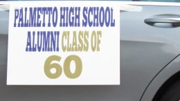 A sign on one of the cars within the parade which the Class of 1960 was represented.