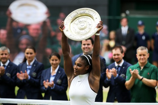 Serena Williams holds up the Venus Rosewater Dish.