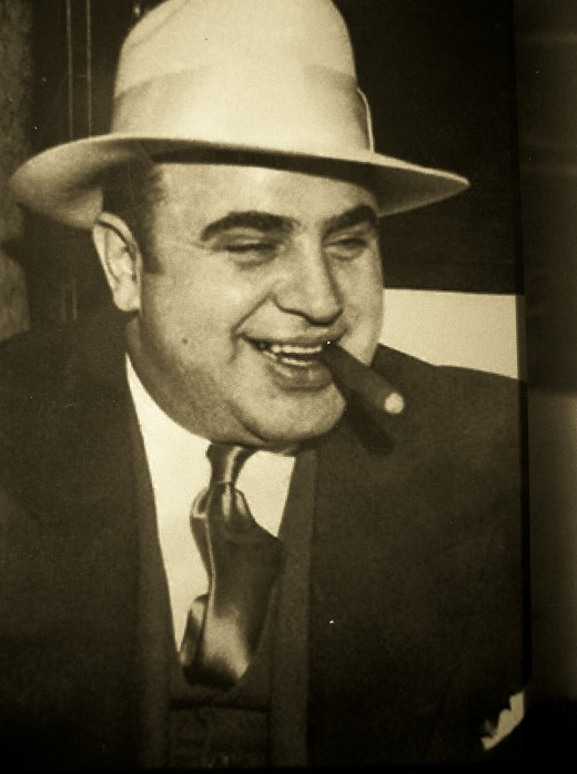 Al Capone was one of the most influential residents of Chicago in the 20th century, and the iconic image of a stout Italian wearing a suit and a fedora smoking a cigar still lives on.