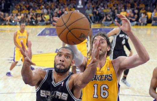 Duncan goes up for rebound against Gasol