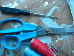 scissors to cut the cords and a bead reamer always makes the cord slide on to the bead much easier